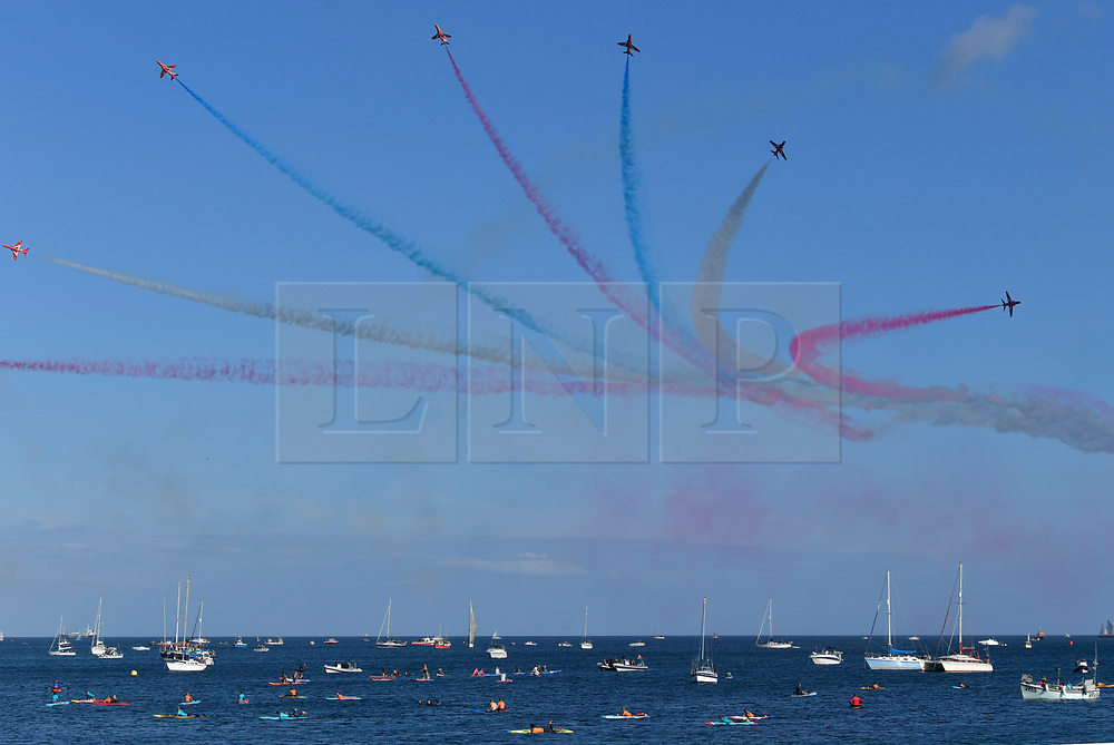 © Licensed to London News Pictures. 09/08/2017 Red Arrows display for the first time in Falmouth Bay. Large crowds attended the first red Arrows display in Falmouth Bay. The location was changed from the traditional Carrick roads location because of new safety rules imposed after the Soreham air disaster.Photo credit : MARK HEMSWORTH/LNP
