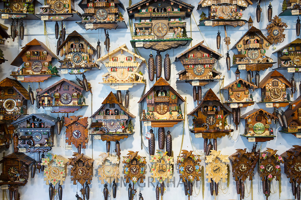 Traditional cuckoo clocks on sale in Geschenkehaus shop in the town of Seefeld in the Tyrol, Austria