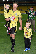 Ben Sigmund of the Phoenix walks from the field with his children after his last game for the Phoenix during the A-League - Wellington Phoenix v Western Sydney football match at Westpac Stadium in Wellington on Sunday the 10 April 2016. Copyright Photo by Marty Melville / www.Photosport.nz