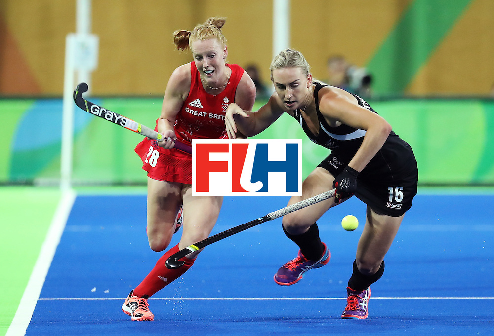 RIO DE JANEIRO, BRAZIL - AUGUST 17:  Liz Thompson #16 of New Zealand and Nicola White #28 of Great Britain and  during the Women's Semifinal match between New Zealand and Great Britain on Day 12 of the Rio 2016 Olympic Games at the Olympic Hockey Centre on August 17, 2016 in Rio de Janeiro, Brazil.  (Photo by Rob Carr/Getty Images)