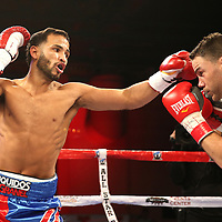 Jose Lopez (L) fights Daniel Lopez during a Telemundo boxing match between at Osceola Heritage Park on Friday, February 23, 2018 in Kissimmee, Florida.  (Alex Menendez via AP)