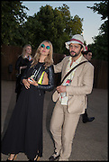 CAROLINA MAZZOLARI,; CONRAD SHAWCROSS;, 2014 Serpentine's summer party sponsored by Brioni.with a pavilion designed this year by Chilean architect Smiljan Radic  Kensington Gdns. London. 1July 2014