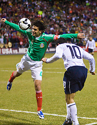 United States midfielder Landon Donovan (10) heads the ball past Mexico defender Rafael Marquez (4) to set up the first goal of the game.  The United States men's soccer team defeated the Mexican national team 2-0 in CONCACAF final group qualifying for the 2010 World Cup at Columbus Crew Stadium in Columbus, Ohio on February 11, 2009.