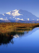 Denali National Park. Mt McKinley / Denali and the still waters of Wonder lake.