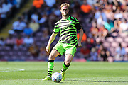 Forest Green Rovers Matt Mills(5) passes the ball forward during the EFL Sky Bet League 2 match between Bradford City and Forest Green Rovers at the Utilita Energy Stadium, Bradford, England on 24 August 2019.