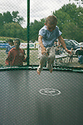 young child on a trampoline