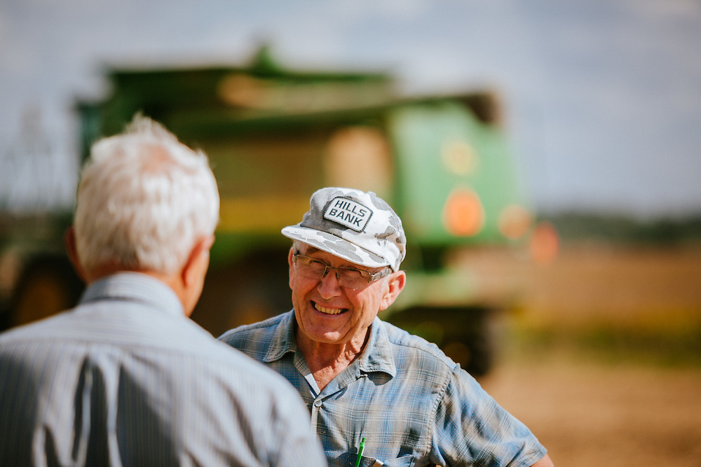 A proud farmer having a delightful conversation.<br /> Photographed by editorial lifestyle Texas photographer Nathan Lindstrom