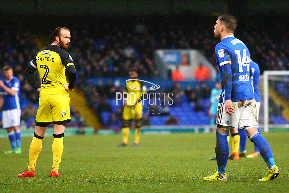 Burton Albion's John Brayford and Ipswich Town's Joe Garner react during the EFL Sky Bet Championship match between Ipswich Town and Burton Albion at Portman Road, Ipswich, England on 10 February 2018. Picture by John Potts.