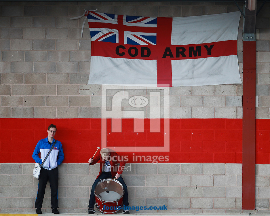 A Fleetwood Town fan tries to create an atmoshere by banging a drum in an empty  Highbury Stadium, Fleetwood<br /> Picture by John Rainford/Focus Images Ltd +44 7506 538356<br /> 01/11/2014