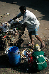 BANGLADESH DHAKA KAWRAN BAZAAR 2MARB05 - Rubbish collectors at work at the Kawran Bazaar vegetable market. The Bazaar has been in the Tejgaon area for at least 30 years and is one of the largest markets in Dhaka city...jre/Photo by Jiri Rezac..© Jiri Rezac 2005..Contact: +44 (0) 7050 110 417.Mobile:  +44 (0) 7801 337 683.Office:  +44 (0) 20 8968 9635..Email:   jiri@jirirezac.com.Web:    www.jirirezac.com..© All images Jiri Rezac 2005- All rights reserved.