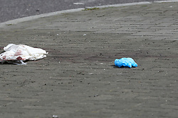 © Licensed to London News Pictures. 13/04/2019. London, UK. Blood stains at the crime scene on Bounds Green Road at the junction of Nightingale Road in North London, where a 19 years old man was stabbed just before 9.30pm on Friday 12 April 2019. The victim remains in a life threatening condition in a central London hospital. Photo credit: Dinendra Haria/LNP
