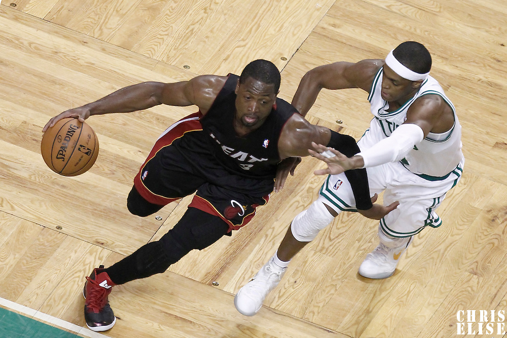01 June 2012: Miami Heat shooting guard Dwyane Wade (3) drives past Boston Celtics point guard Rajon Rondo (9) during the first half of Game 3 of the Eastern Conference Finals playoff series, Heat vs Celtics, at the TD Banknorth Garden, Boston, Massachusetts, USA.