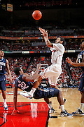 LOUISVILLE, KY - JANUARY 25: Peyton Siva #3 of the Louisville Cardinals shoots the ball after bumping into James Bell #32 of the Villanova Wildcats during their game at KFC Yum! Center on January 25, 2012 in Louisville, Kentucky. (Photo by Joe Robbins)