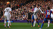 Chris Smalling heads clear the danger during the Barclays Premier League match between Crystal Palace and Manchester United at Selhurst Park, London, England on 31 October 2015. Photo by Michael Hulf.