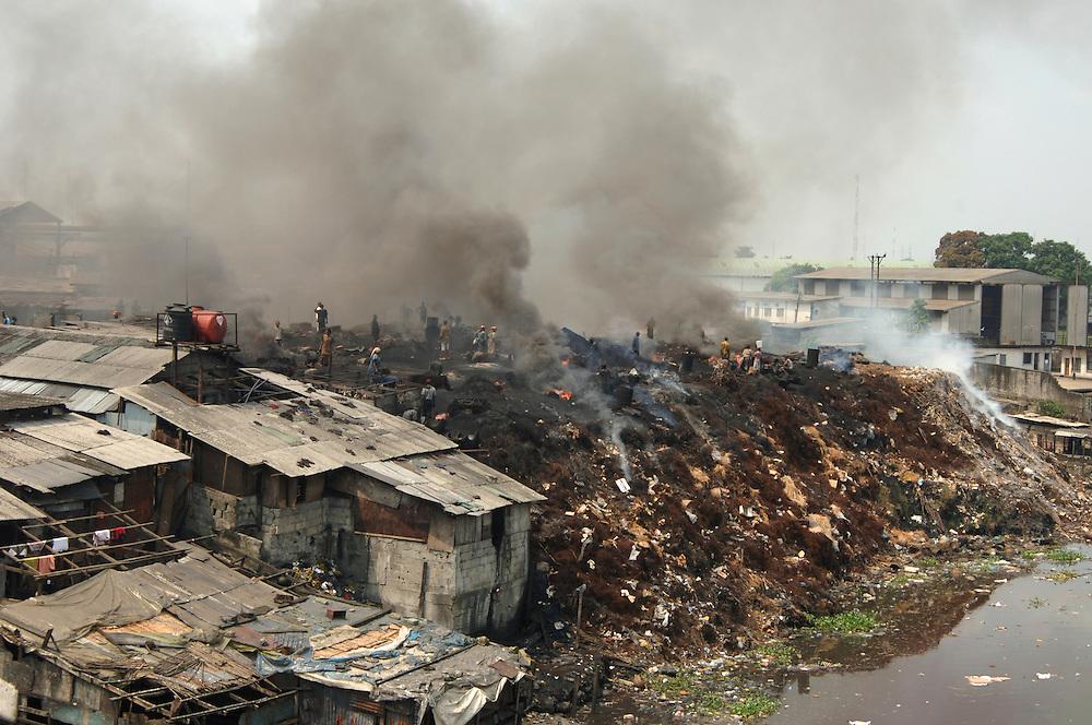 Burning rubbish dump on outskirts of Port Harcourt, Nigeria