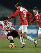 n/z.: Tomasz Moskala (nr18-Cracovia), Marcin Kuzba (nr31-Wisla) podczas meczu ligowego Wisla Krakow (czerwone) Cracovia Krakow (czerwone-biale) 3:0 , I liga polska , 4 kolejka sezon 2005/2006 , pilka nozna , Polska , Krakow , 22-11-2005 , fot.: Adam Nurkiewicz / mediasport..Tomasz Moskala (nr18-Cracovia), Marcin Kuzba (nr31-Wisla) fight for the ball during Polish league first division soccer match in Cracow. November 22, 2005 ; Wisla Krakow (red) - Cracovia Krakow (red-white) 3:0 ; 4 round season 2005/2006 , football , Poland , Cracow ( Photo by Adam Nurkiewicz / mediasport )