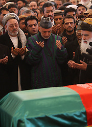 61197472<br /> Afghan president Hamid Karzai (C) prays during funeral ceremony of Afghan Vice President Marshal Mohammad Qasim Fahim, at the Presidential Palace in Kabul, Afghanistan on March 11, 2014. The state funeral service for Afghan First Vice President Marshal Mohammad Qasim Fahim was held amid tight security in the Presidential Palace on Tuesday, 11th March 2014. Picture by  imago / i-Images<br /> UK ONLY