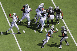 EAST RUTHERFORD, NJ - SEPTEMBER 7: Geno Smith (7) of the New York Jets throws a pass during a game against the Oakland Raiders at MetLife Stadium on September 7, 2012 in East Rutherford, NJ.  (Photo by Ed Mulholland/Getty Images)