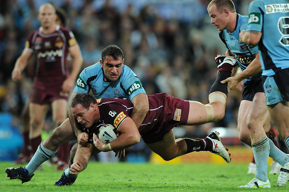 May 25th 2011: Matthew Scott of the Maroons is tackled by Tim Mannah of the Blues during game 1 of the 2011 State of Origin series at Suncorp Stadium in Brisbane, Australia on May 25, 2011. Photo by Matt Roberts/mattrIMAGES.com.au / QRL