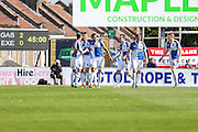 Bristol Rovers players celebrate Lee Brown's goal on the stroke of half time to make it 2-0 during the Sky Bet League 2 match between Bristol Rovers and Exeter City at the Memorial Stadium, Bristol, England on 23 April 2016. Photo by Shane Healey.