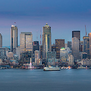 Summer sunset view of Downtown Seattle across Elliott Bay from Hamilton Viewpoint Park, West Seattle. Photo by Alabastro Photography.