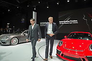 Manhattan, New York, USA. April 12, 2017.  L-R, KLAUS ZELLMER, President and Chief Executive Officer of Porsche Cars North America, Inc, and ANDREAS PREUNINGER, GT Project Director Porsche AG, introduce two new cars making their North American Premiere: Panamera Sport Turismo (silver car on left) and 911 GT3 (red car on right) during the Porsche Press Conference at the New York International Auto Show, NYIAS, during the first Press Day at the Javits Center.