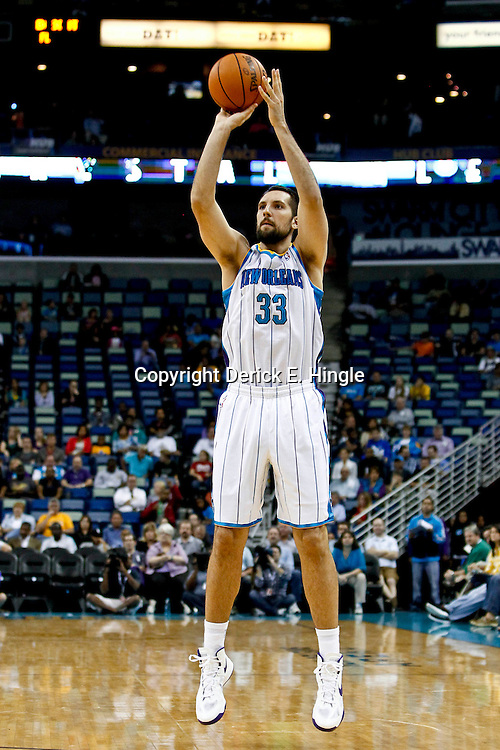 October 9, 2012; New Orleans, LA, USA; New Orleans Hornets forward Ryan Anderson (33) shoots against the Charlotte Bobcats during the first quarter of a game at the New Orleans Arena.   Mandatory Credit: Derick E. Hingle-US PRESSWIRE