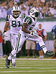 Sept 19, 2011; East Rutherford, NJ, USA; New York Jets running back LaDainian Tomlinson (21) and New York Jets tight end Dustin Keller (81) celebrate Tomlinson's first down run during the 2nd half at the New Meadowlands Stadium.  The Jets defeated the Patriots 28-14.