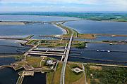 Nederland, Zeeland, Krammer, 22-05-2011; Krammersluizen met Philipsdam (afsluiting van  Krammer en Volkerak van de Oosterschelde), Grevelingendam tussen Schouwen-Duiveland (Zeeland) en Goeree-Overflakkee (Zuid-Holland) in de achtergrond..Krammer sluices and Philips dam Grevelingendam in the background, south-west Netherlands, part of the Delta Project..luchtfoto (toeslag), aerial photo (additional fee required).foto/photo Siebe Swart