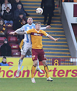 Dundee's James McPake out jumps Motherwell's Lee Erwin - Motherwell v Dundee, SPFL Premiership at Fir Park<br /> <br />  - &copy; David Young - www.davidyoungphoto.co.uk - email: davidyoungphoto@gmail.com