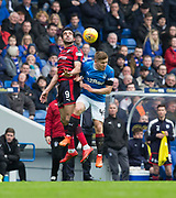 7th April 2018, Ibrox Stadium, Glasgow, Scotland; Scottish Premier League football, Rangers versus Dundee; Sofien Moussa of Dundee competes in the air with Greg Docherty of Rangers