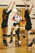 Maquoketa's Allison Vandemore (5) watches her spike sail between Solon's Kelsey Hinrichs (10) and Vik Meade (28) during the WaMaC Tournament Championship game at Mount Vernon High School in Mount Vernon on Thursday October 11, 2012. Solon defeated Maquoketa 17-25, 25-15, 15-10.