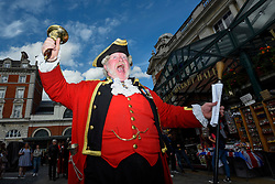 "© Licensed to London News Pictures. 20/06/2019. LONDON, UK.  Alan Myatt, town crier, and a marching band take part in the historical ""Rent Ceremony"" in Covent Garden.  A parade of the Covent Garden Area Trust's trustees accompanied by the Lord Mayor of Westminster, Deputy Mayor of Camden and other dignatories as well as street entertainers march around the piazza where the trustees pay a symbolic ""peppercorn rent"" consisting of five rosy red apples and five posies of flowers and posies are paid as rent to the landlords.  Photo credit: Stephen Chung/LNP"