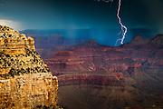 Lightning strikes behind a ridge near Claude Birdseye Point at Grand Canyon National Park.