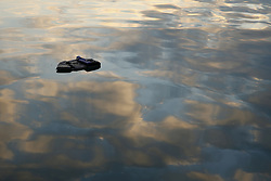 A lifejacket floats on the surface of the water at the port of Mytilene on the Greek island of Lesbos, January 29, 2016. REUTERS/Darrin Zammit Lupi MALTA OUT. NO COMMERCIAL OR EDITORIAL SALES IN MALTA - RTX24KXJ