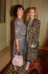 Actress ROSAMUND PIKE and her mother at a fashion show of Sybil Stanislaus Summer 2005 collection with jewellery by Philippa Holland held at The Lanesborough Hotel, Hyde Park Corner, London on 13th April 2005.<br />