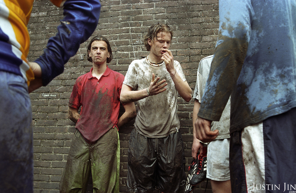 Wealthy Dutch teenagers get cold and muddy during an Easter camp in middle-Holland. They had been climbing through mud and wood obstructions. .Picture shot in Amsterdam in 2004 by Justin Jin. .