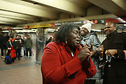 Alice Tan Ridley, mother of Oscar nominated ' Precious ' star Gabourey Sidibe, sings R&B and Gospel tunes from her ampified enabled Ipod to unsuspected New York City subway passengers at the 34th Street BDFQ Subway station on February 6, 2009 in New York City. Photo Credit: Terrence Jennings/Retna,Ltd