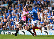 Portsmouth striker Gareth Evans and Northampton Town Midfielder John-Joe O'Toole during the Sky Bet League 2 match between Portsmouth and Northampton Town at Fratton Park, Portsmouth, England on 7 May 2016. Photo by Adam Rivers.