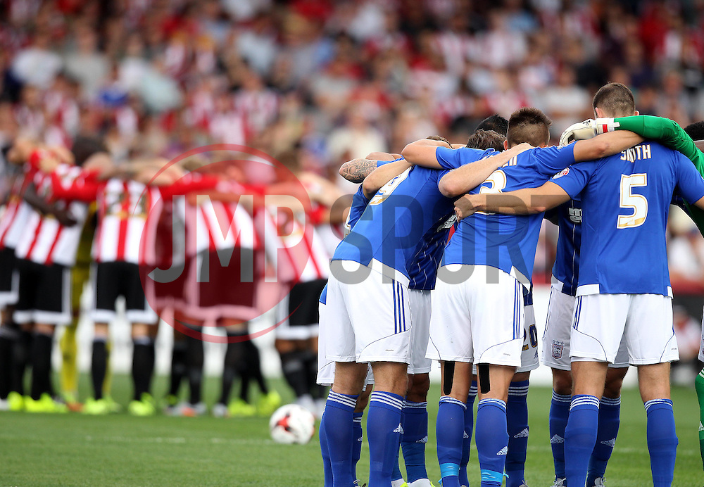 Ipswich Town and Brentford huddle before kick off - Mandatory by-line: Robbie Stephenson/JMP - 07966386802 - 08/08/2015 - SPORT - FOOTBALL - Brentford,England - Griffin Park - Brentford v Ipswich Town - Sky-Bet Championship
