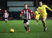 Brentford midfielder Ryan Woods trying to inspire Brentford during the Sky Bet Championship match between Brentford and Burnley at Griffin Park, London, England on 15 January 2016. Photo by Matthew Redman.