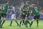 Scunthorpe United midfielder Neil Bishop (12) celebrates with team mates after scoring the second goal during the League 1 match between Peterborough United and Scunthorpe United at London Road, Peterborough, England on 22 November 2016. Photo by Nigel Cole.