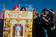 Feast of Corpus Christi. In procession with the banner, the embrodery is a constant of the Andean festivities
