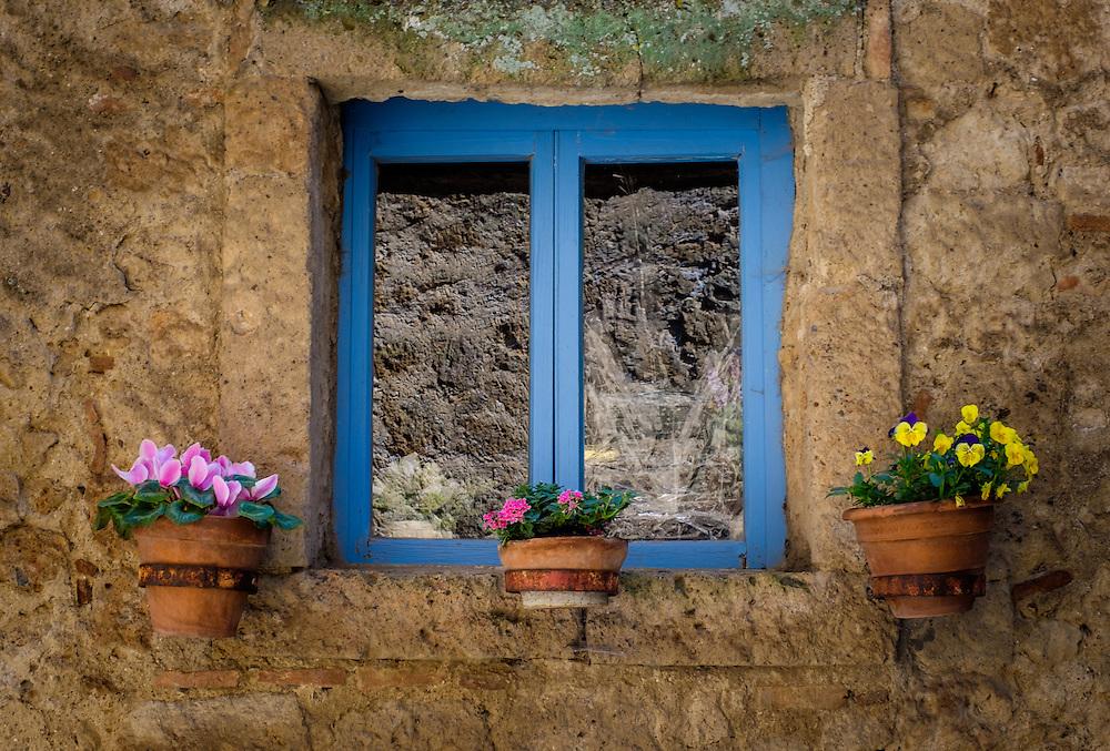 CIVITA DI BAGNOREGIO ITALY - CIRCA MAY 2015: Decorated window with flower pots in Civita di Bagnoregio.