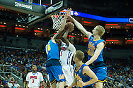 19 MAR 2015: Ryan Manuel (1) of Southern Methodist University tries to get past Gyorgy Goloman (14), Thomas Welsh (40), and Bryce Alford (20) on the University of California Los Angeles during the 2015 NCAA Men's Basketball Tournament held at the KFC Yum! Center in Louisville, KY. UCLA defeated SMU 60-59. Brett Wilhelm/NCAA Photos