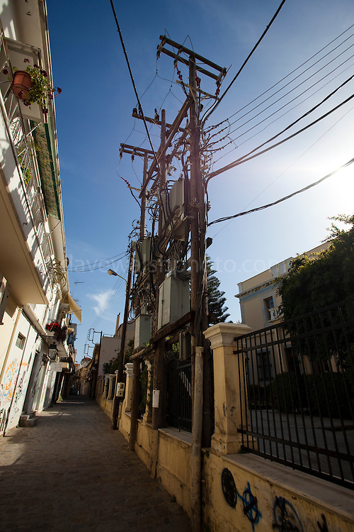 Electrical power cables in Rythmno, Crete. The tourist season puts a heavy loads on Crete's electrical grid every summer. There is strong potential for further development of wind energy in Crete, which leads Greece in renewable energy generation. Current research suggests that wind could account for up to 70% of Crete's energy needs. Crete already has 160 mw of wind power with another 60 megawatts expected to be taken up soon, and 90 megawatts of photovoltaic solar farms are also expected.