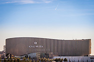 A panoramic view of The Royal Arena in Copenhagen, in landscape, set against a blue sky.