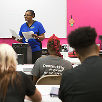 Student instructor Leslie Marion goes over a review guide about the anatomy and physiology of the skin layers in the freshman level classroom at the Tupelo Academy of Cosmetology. Marion is one of four student instructors, and there are 5 staff instructors.