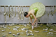 MR. Model relased photo. Ballerina poses with all the dancing shoes used during her career