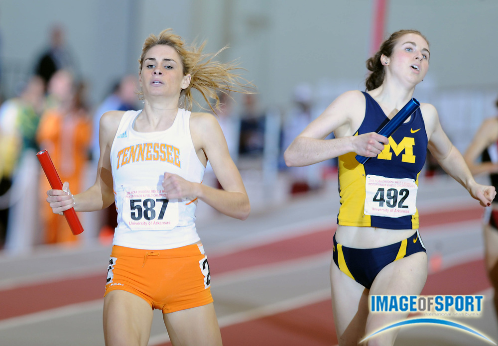 Mar 14, 2008; Fayetteville, AR, USA; Sarah Bowman of Tennessee holds off Nicole Edwards of Michigan on the 1,600m anchor of the women's distance medley relay in the NCAA indoor track and field championships at the Randal Tyson Center. Tennessee won in 11:01.97 and Michigan was second in 11:02.22.